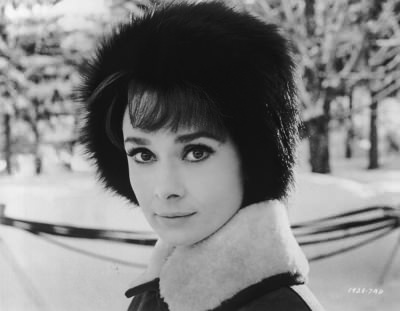Audrey Hepburn steps out in the snow in a fur hat