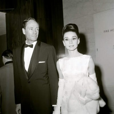 Mel Ferrer and Audrey Hepburn, holding a Fur Coat, British Film Academy Awards, April 1964