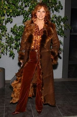 Raquel Welch in a floor length fur lined coat