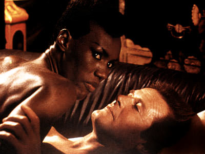 Grace Jones & Roger Moore, appeared together in 'A View to Kill'