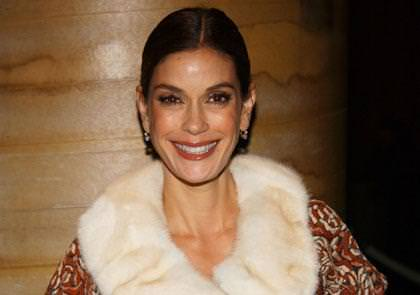 A fresh faced Teri Hatcher dressed in a fur collar coat