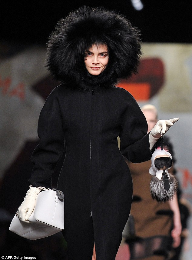 Cara Delevingne strutting with Karl Lagerfeld's Karlito - Fendi - Fall 2014-Winter 2015
