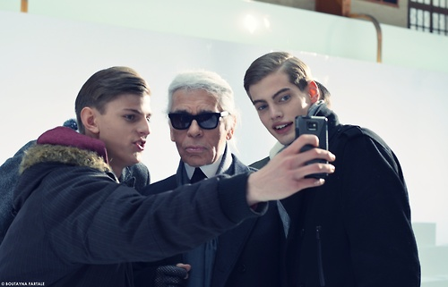 Elvis Jankus taking a selfie with Lagerfeld and Justus Einsfeld after Dior's Fall 2013:Winter 2014