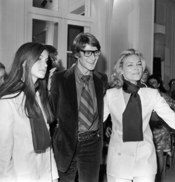 Yves Saint-Laurent with Bacall and her daughter Leslie at a showing of his latest collection in Paris in 1968.