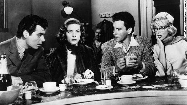 Rory Calhoun, Lauren Bacall, Cameron Mitchell, and Marilyn Monroe sitting in diner in a scene from the film 'How To Marry A Millionaire', 1953. (Photo by 20th Century-Fox/Getty Images)