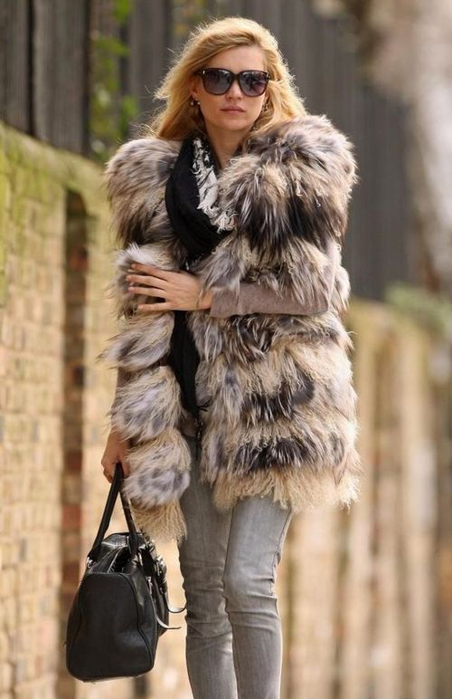 Kate Moss favors her fur and jeans look