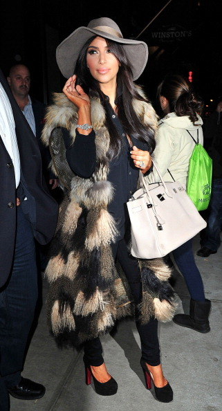 Kim Kardashian in a sleeveless coat, 2011 in New York City.  (Photo by James Devaney/WireImage)