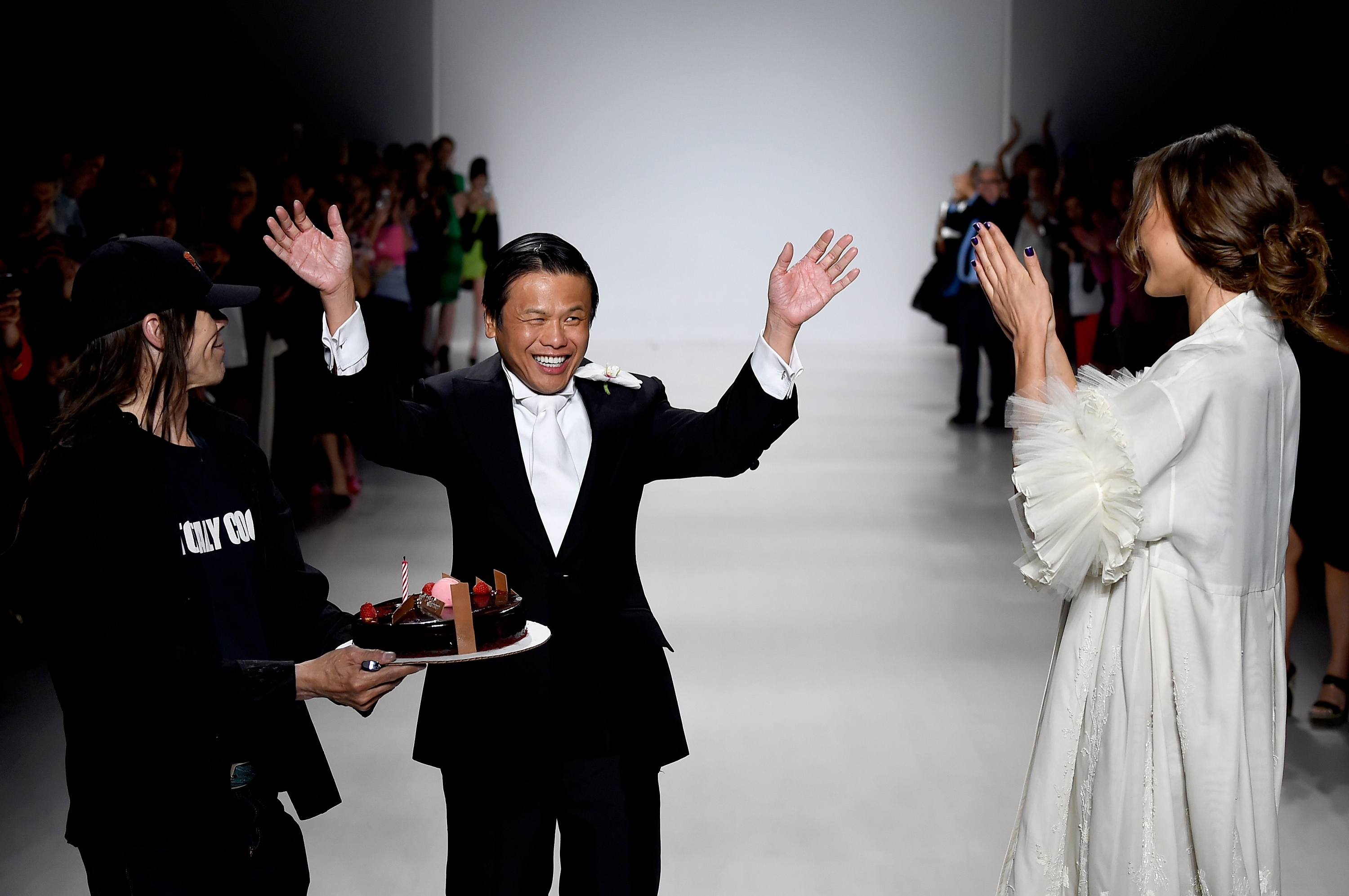 Zang Toi received an impromptu cake from the photographers to celebrate his 25th anniversary collection during Mercedes-Benz Fashion Week Spring 2015