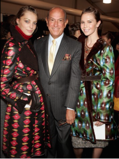 Oscar de la Renta backstage with models during his fall 2005 fashion show during Olympus Fashion Week in New York