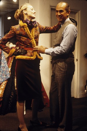 Oscar de la Renta fitting a model for his Fall 1979-Winter 1980 collection