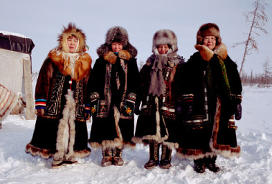 A group of Dolgan women in traditional winter reindeer skin clothing. Taymyr, Northern Siberia, Russia.