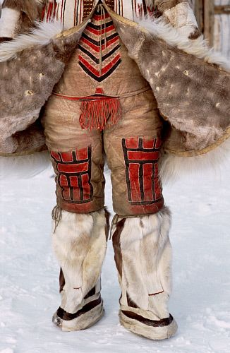A traditional Nganasan woman's combination reindeer skin under garment worn together with knee length boots. Taymyr, Northern Siberia, Russia.