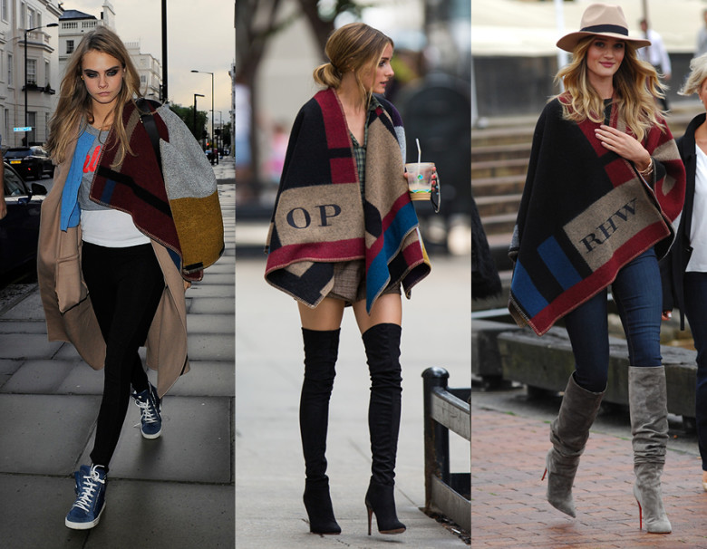 Burberry Prorsum poncho from their fall 2014 seen here worn by (L to R) Cara Delevingne, Olivia Polermo, Rosie Huntington-Whiteley