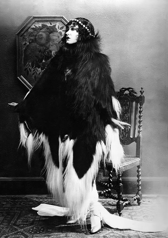 Gloria Swanson vamping in a black and white monkey fur coat, 1920s