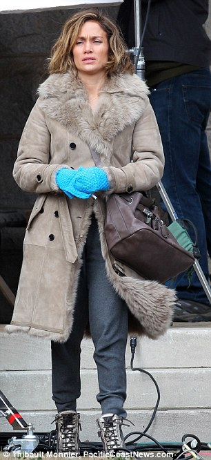 "Jennifer Lopez was spotted on the set of her upcoming movie ""Lila & Eve"" earlier this year in a grey-tone shearling."