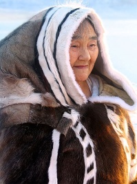 Inuit elder Qappik Attagutsiak in her traditional caribou and sealskin clothes. Arctic Bay, Baffin Island, Nunavut, Canadian high Arctic. Photo by Sue Flood.