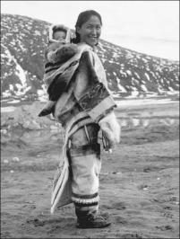 Inuit woman and baby. In many Arctic regions, a pouch is sewn onto the back of a woman's parka to hold her child