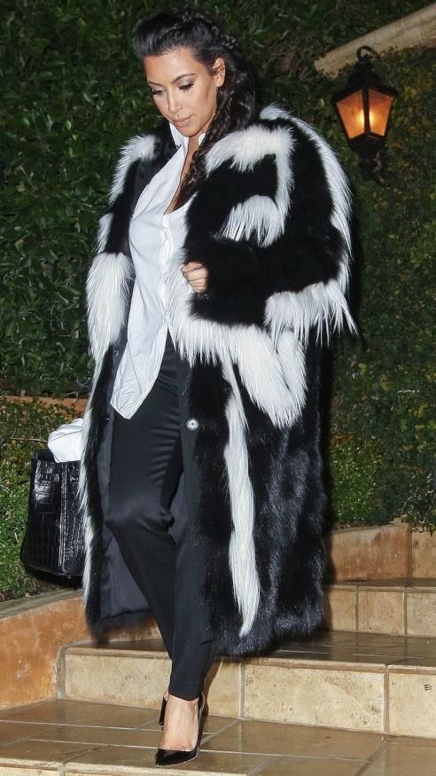 Kim Kardashian wearing a skunk style fur coat
