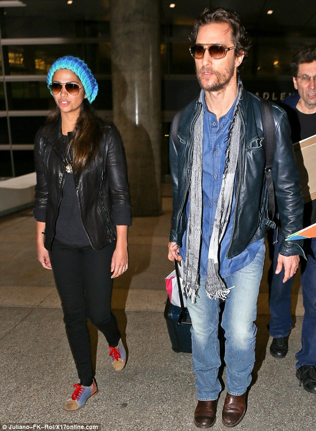 Matthew McConaughey and his wife Camila Alves touched down in LAX after a trip to Shanghai.