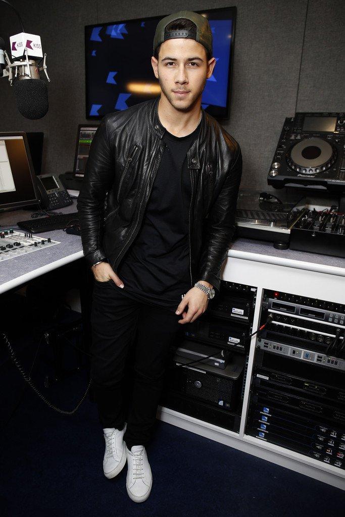 Nick Jonas wearing a Maison Martin Margiela leather motorcycle jacket