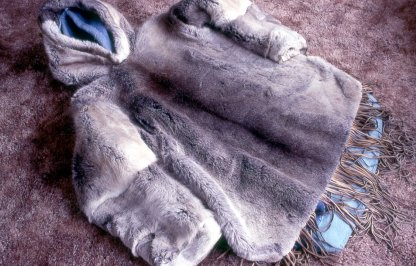 The traditional parka is a heavy outer jacket with the fur facing outwards worn with a second jacket of the same fur (the ATIGI), worn beneath it with the fur facing inwards. (JohnTyman)