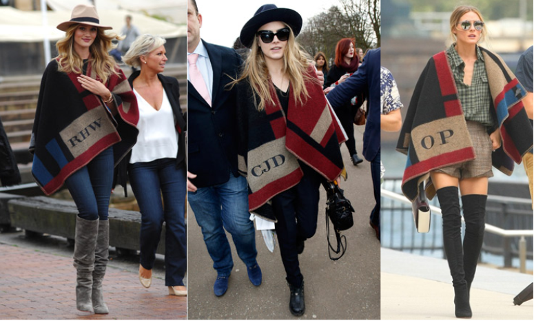 One of the hottest fashion accessories of the season is the Burberry oversized monogrammed scarf/ cape