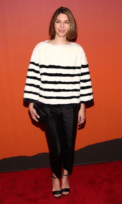 Director Sofia Coppola attended a red carpet event in a stylish Louis Vuitton mink pullover that earned her a best dressed nod.
