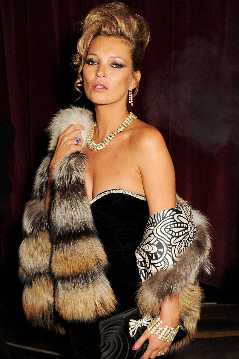 Kate Moss channeling retro glam with diamonds and fox