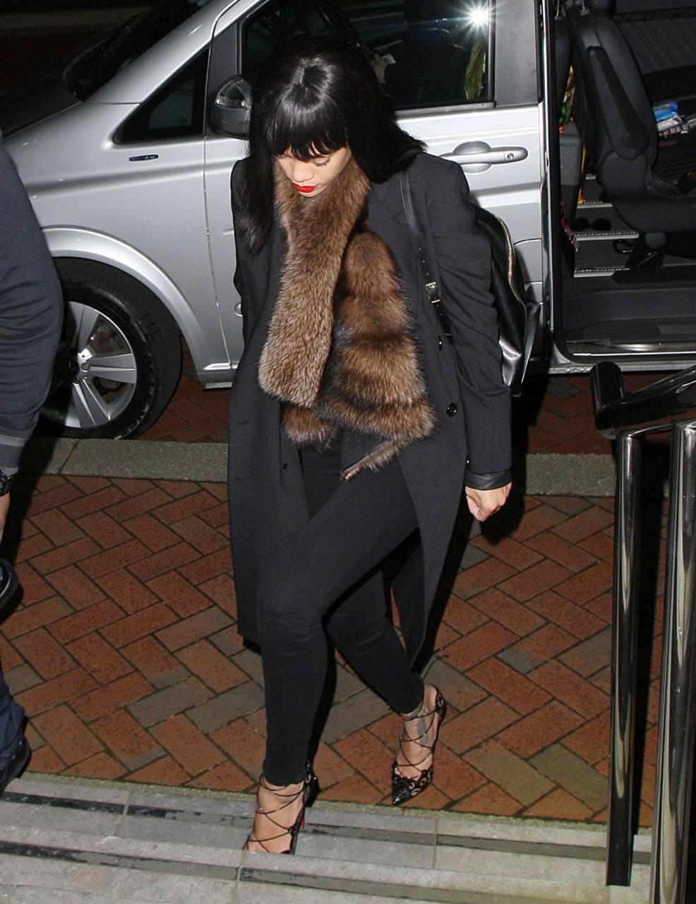 The simplest touches of fur, like Rihanna's sable scarf, brings a finished touch to even the simplest ensemble
