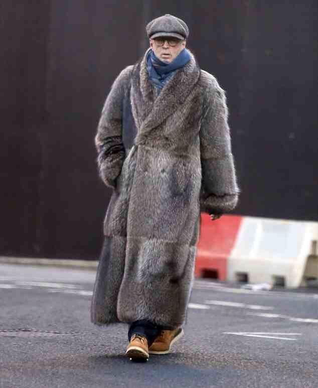 Singer Eric Clapton made the rounds around the Holidays draped in full fur.