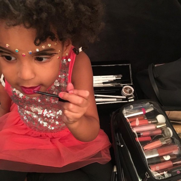 Beyonce's daughter Blue Ivy experimenting in her mother's makeup case