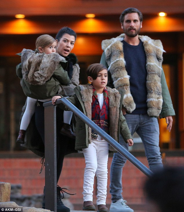 A family that furs together.... Parents Kourtney Kardashian and Scott Disick are pictured with their kids Penelope and Mason, as part of their luxury skiing break in the snowy hills of Vail, Colorado on April 8 2016