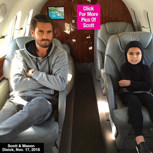 Scott Disick hangs out with son Mason Disickas they wait to take off for an adventure on a Private jet