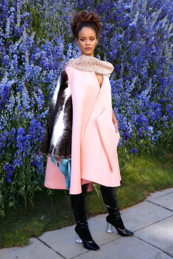 Rihanna rocking a fur sleeve cape from Dior's Spring 2016 collection
