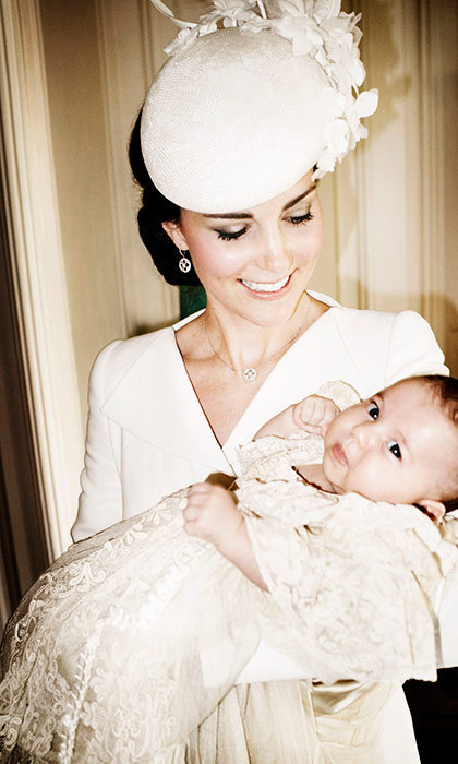 Dutchess Kate holding 2-month-old Princess Charlotte at her baptism in 2015