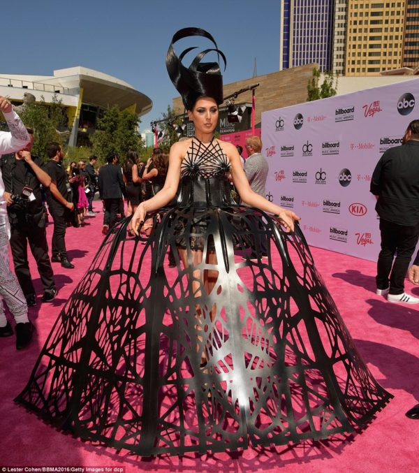 We are mentioning this only because it's like the 10,000lb elephant in the room. Electro-pop singer Z LaLa ASSumed she was making a statement in this dress. Well, you know what they say about assuming.