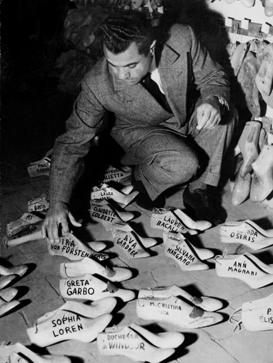 Salvatore Ferragamo surveying the foot forms of some of his famous celebrity clients