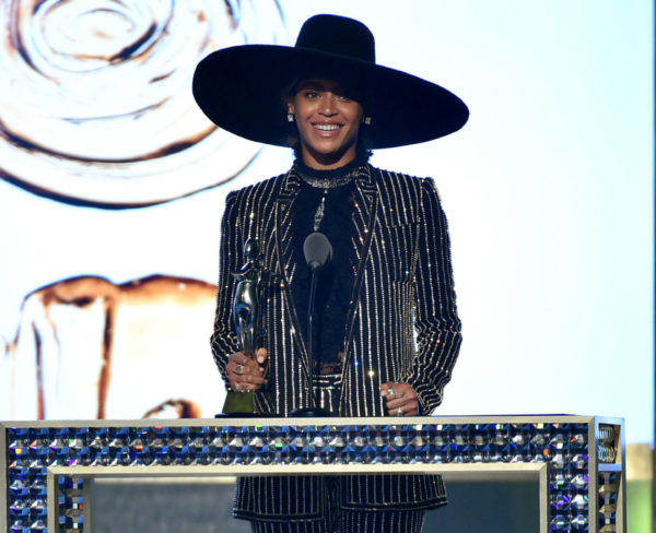Beyoncé accepts the CDFA Fashion Icon award