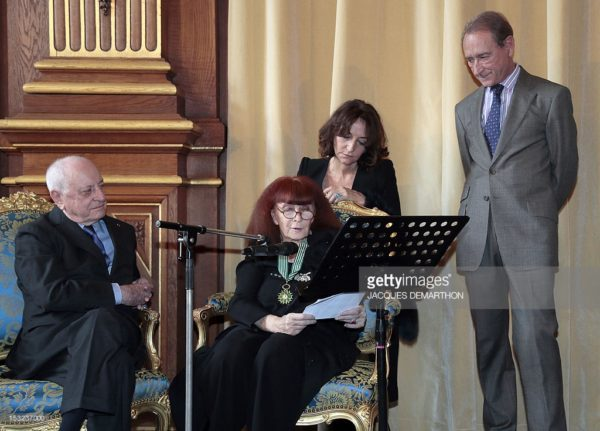 2012 French fashion designer Sonia Rykiel (C), next to her daughter Nathalie Rykiel (2nd R) speaks after awarded Commandeur of the Arts and Letters order by French businessman Pierre Berge (L) and received the medal of the city of Paris