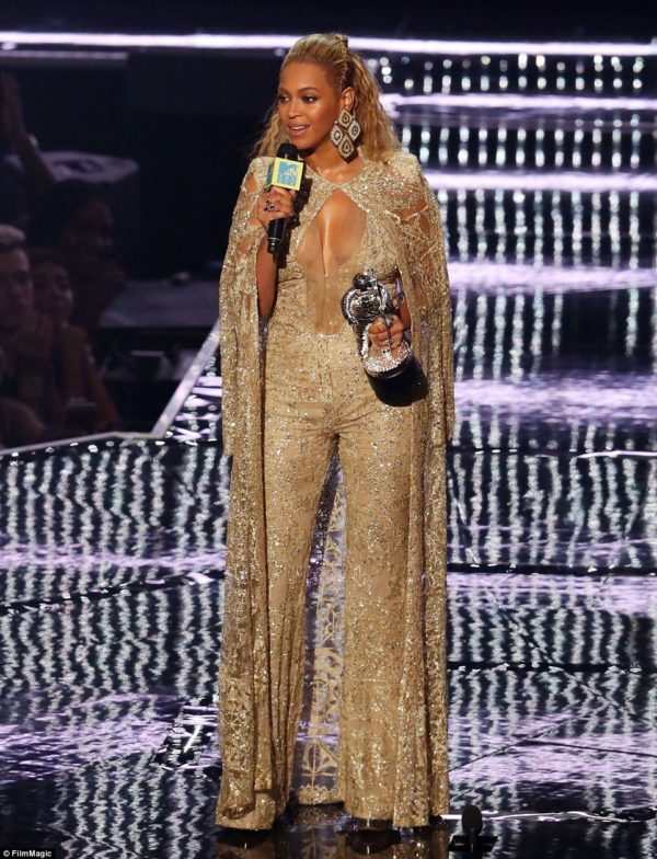 Definitely the night's all-around winner; Beyonce in a striking gold jumpsuit by ????