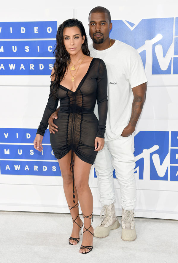 Kim Kardashian and Kanye West in Yeezy. We're not surprised at the sexy look Kim pulled off, but rather that her look was simple yet stunning from head to toe