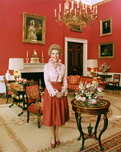 Nancy Reagan,1981, wearing Bill Blass while in te red room at the White House