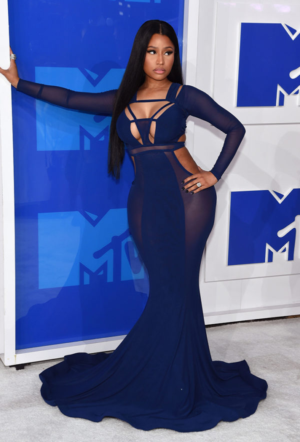 "Nicki Minaj in Bao Tranchi was giving vibes of a different ""ménage"" in this ultra sexy peek-a-boo dress"
