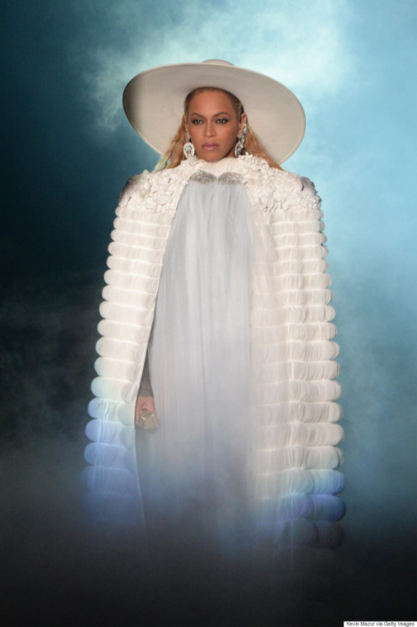 Opening her epic 16 minute performance Beyonce wore a Ralph & Russo white silk organza cape