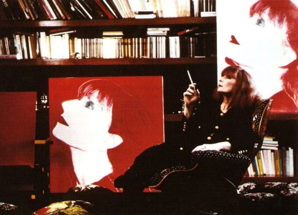 Sonia Rykiel at home along her Andy Warhol portraits