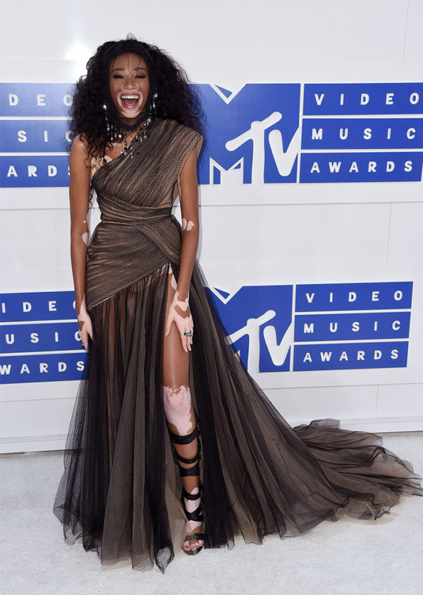 Winnie Harlow in Nicolas Jebran - Too much dress for such a little frame. We wished she would have worn a more youthful and colorful dress to accent her natural beauty