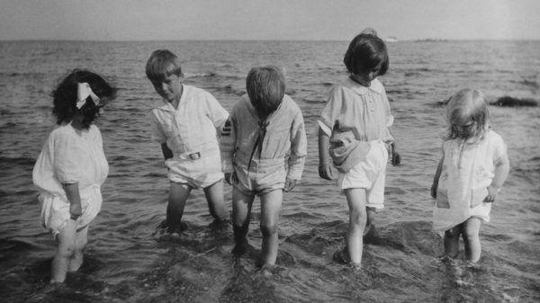 Children from 1924 getting their final splash in wearing their summer whites