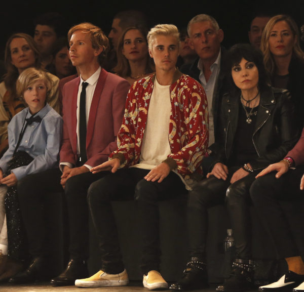 Musicians Beck (L), Justin Bieber (C) and Joan Jett watch the Saint Laurent fall collection during a fashion show at the Hollywood Palladium in Los Angeles, California February 10, 2016. REUTERS/Mario Anzuoni