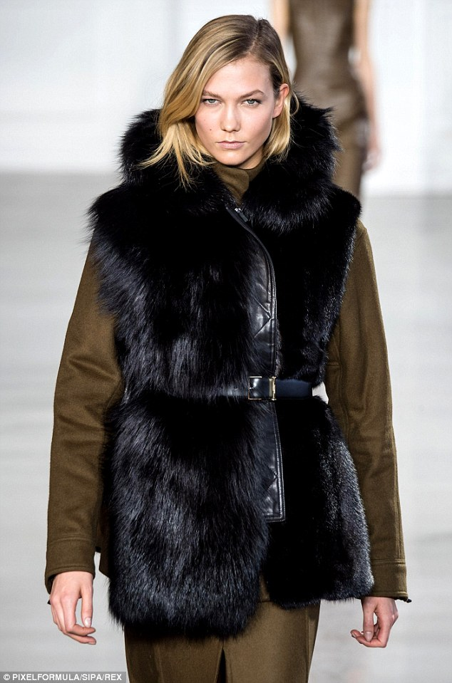 Modern and sexy Karlie Kloss embodied the All-American girl while walking the runway in a green dress and fur jacket at the Jason Wu Fall 2015 Show