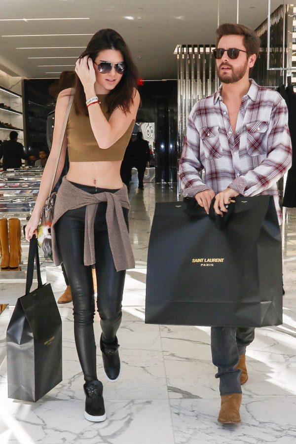 Kendall Jenner and Scott Disick holding Saint Laurent bags shopping for the holidays on Rodeo Drive